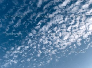 The blue sky with white wispy clouds